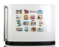 Souvenir magnets of the cities of Europe. On the door of the refrigerator Stock Photography