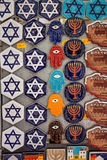 Souvenir magnets with jewish symbols (Magen David, menorah, hams. Krakow, Poland - September 7, 2016: Souvenir magnets with jewish symbols (Magen David, menorah Stock Photography