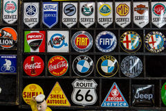 Souvenir magnets with logos of famous automotive brands, oil companies and beverage producers. Royalty Free Stock Photo