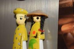 Souvenir magnets from vietnam on fridge royalty free stock photo