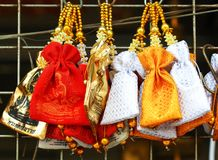 Souvenir for major festivals of Thailand. One silver and one gold container of something royalty free stock image