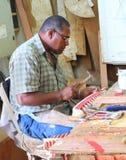 Souvenir maker. Stock Photos