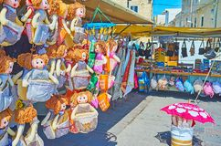 The souvenir market of Marsaxlokk. Is the nice place to choose some gifts, such as traditional Maltese embroideries, sun umbrellas, magnets, accessories or stock photography