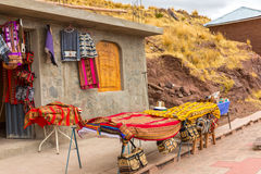 Souvenir market near towers in Sillustani, Peru,South America. Street shop with colorful blanket Royalty Free Stock Images
