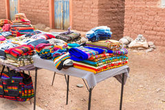 Souvenir market near towers in Sillustani, Peru,South America. Street shop with colorful blanket, scarf, cloth, ponchos Royalty Free Stock Photography