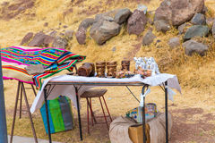 Souvenir market near towers in Sillustani, Peru,South America. Street shop with colorful blanket, scarf, cloth, ponchos Stock Images