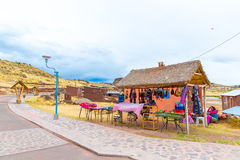 Souvenir market near towers in Sillustani, Peru,South America. Street shop with colorful blanket, scarf, cloth, ponchos Royalty Free Stock Photos