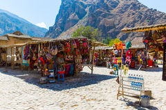 Souvenir market on street of Ollantaytambo,Peru,South America. Colorful blanket, cap, scarf, cloth, ponchos Royalty Free Stock Photo