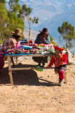 Souvenir market on street of Ollantaytambo,Peru,South America. Colorful blanket, cap, scarf Royalty Free Stock Image