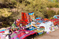 Souvenir market in Tambomachay,Peru,South America  Street shop with colorful blanket, scarf, cloth, ponchos Stock Photos