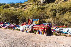 Souvenir market in Tambomachay,Peru,South America  Street shop with colorful blanket, scarf, cloth, ponchos Stock Images
