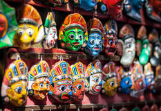 Souvenir masks at Nepal market Royalty Free Stock Photo