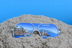 Souvenir from Monaco. In the sand with blue background Stock Photos