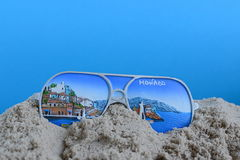 Souvenir from Monaco. In the sand with blue background Stock Photography