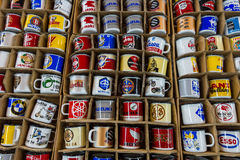 Souvenir mugs with logos of famous automotive brands, oil companies and beverage producers. Royalty Free Stock Photos