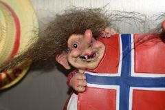 Souvenir norvegian porcelain ceramic flag. Witch scary heary magnets from travel Royalty Free Stock Photos