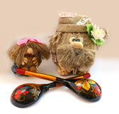Souvenir old Brownie toy and granddaughter painted spoons Hand-m Stock Image