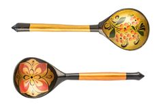 Souvenir old painted spoons Hand-made isolated on a white background. royalty free stock photo