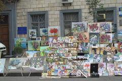 Souvenir paintings sold on the street Stock Images