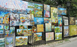 Souvenir paintings sold on the street Royalty Free Stock Images