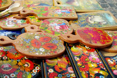 Souvenir paintinted with flowers. Souvenirs wooden board painted with colorful flowers and birds sold on the street in Andreevsky spusk in Kiev, Ukraine Royalty Free Stock Image