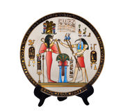 Souvenir Plate Egypt. The Egyptian souvenir plate with the image of stages from ancient myths on a support. Isolated on white Royalty Free Stock Images