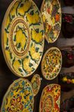 A Souvenir Plate with an Italian design for sale in Tropea, Italy. A Souvenir Hand-painted ceramic plate with an Italian design for sale in Tropea, south Italy stock images