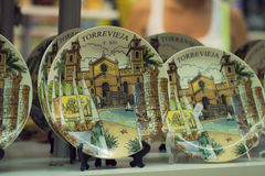 Souvenir plates Torrevieja. TORREVIEJA, SPAIN - SEPTEMBER 8, 2014: Souvenir plates in the tourist shop Torrevieja, Valencia, Spain Royalty Free Stock Images
