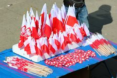 Souvenir Polish flags at a street market in Old Town of Warsaw on the 1st of May, The International Workers Day. Warsaw, Poland - May 1, 2019: Souvenir Polish royalty free stock photos