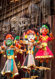 Souvenir Puppets hanging in the street of Nepal. Souvenir puppets hanging to sell in the street shops of Bhaktapur Royalty Free Stock Image