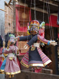 Souvenir puppets hanging in  the street shop in Bhaktapur, Nepal Royalty Free Stock Image