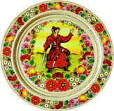 Souvenir, аrt, plate, isolated. Souvenir - a plate with a picture of cossack Stock Photography