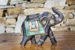 Souvenir: sandal wood elephant. A figurine of an indian elephant decorated with pieces of stones Royalty Free Stock Image