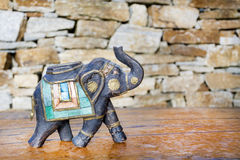 Souvenir: sandal wood elephant. A figurine of an indian elephant decorated with pieces of stones Stock Photo