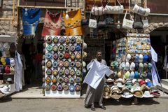 A souvenir seller tries to entice customers into his store at Philae in Aswan, Egypt. Stock Photos