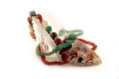 Souvenir - a shoe with a beads from jewels Stock Photo
