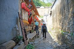 A souvenir shop in Cuandixia village. The tiny souvenir shop is situated within a small hidden narrow street of Cuandixia village. The colorfull goods are stock photography