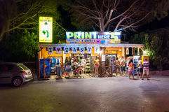 Souvenir shop in Laganas at night. Laganas, Zakynthos Island, Greece - August 25, 2015: Tourists visit colorful souvenir shop at night. Laganas is a very popular stock images