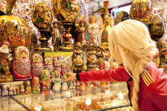 Souvenir shop in the old Arbat  Moscow. blonde girl chooses souvenir. Souvenir shop in the old Arbat in Moscow. blonde girl chooses souvenir Royalty Free Stock Images