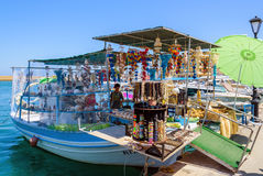 Souvenir shop, organised on fishing boat at port of Chania Royalty Free Stock Photos