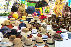 Souvenir shop in Sardinia, Italy. Olbia, Italy - August 24, 2016: Objects of all kinds in a souvenir shop highlighting panama hat in a flea market in  Olbia Royalty Free Stock Photo