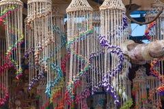 Souvenir shop on the ship. Colorful shells on strings. Harbor in Rhodes, Greece. Souvenir shop on the ship. Colorful shells on strings Royalty Free Stock Photography