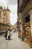 Souvenir shop and tourists in Segovia Stock Photography