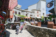 Souvenir Shops. Mostar. MOSTAR, BOSNIA AND HERZEGOVINA - MAY 18, 2013: Tourists look at the souvenir shops and local crafts in Mostar. On May 18, 2013 in Mostar Royalty Free Stock Image