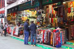 Men are buying souvenirs at the souvenir shops in the Old Town in Shanghai, China Stock Photography