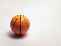 Souvenir small basketball ball on paper back. Souvenir small basketball ball on white Stock Image