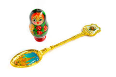 Souvenir spoon and matreshka Royalty Free Stock Photo