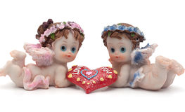 Souvenir of St. Valentine's Day. Two small ceramic angel congratulate Happy Valentine's Day Royalty Free Stock Photography