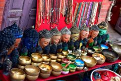Souvenir stall nearby Buddanath stupa Nepal. In the center of the Kathmandu Valley stands the beautiful Boudhanath stupa. At the top, the huge white dome looks Royalty Free Stock Image