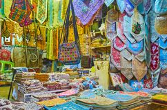 Silk goods in Vakil Bazaar, Shiraz, Iran. The souvenir stall with silk tapestries, dinner napkins, pillowcases, female bags, tablecloths and other goods, Vakil stock images